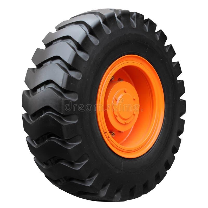 Orange tractor wheel. Isolated on white background royalty free stock photos
