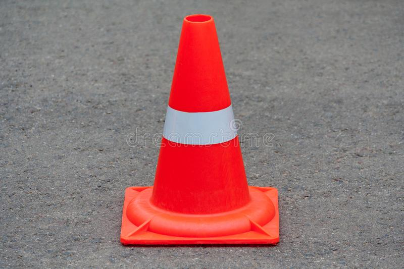 Orange traffic cone royalty free stock photography