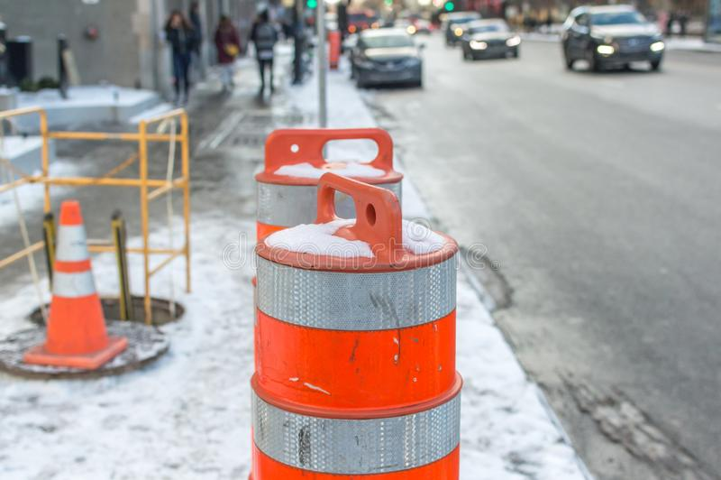 The orange traffic cone on the sidewalk in Montreal downtown. Canada stock photo