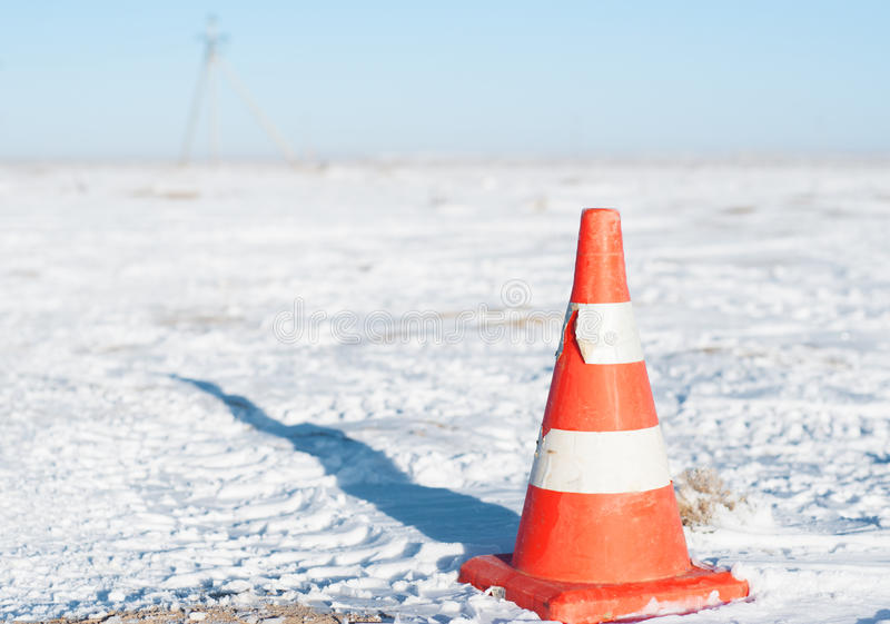 Orange traffic cone used for traffic warning and control. royalty free stock photo