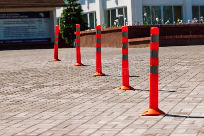 Orange traffic pillar on the road and on parking lane.  stock photos