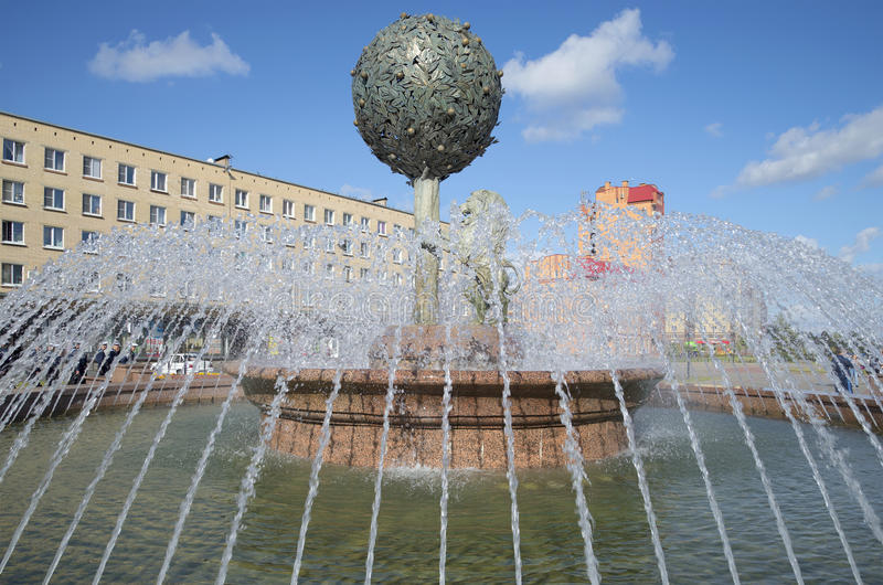 Orange tree in the water jets. The fountain in the town of Lomonosov. Russia royalty free stock images