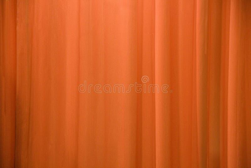 Orange Trennvorhanghintergrund stockbild