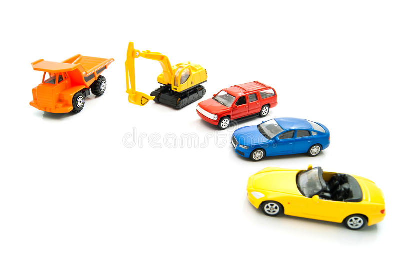 Orange truck, backhoe and other cars. Truck, backhoe and other cars on white closeup royalty free stock image