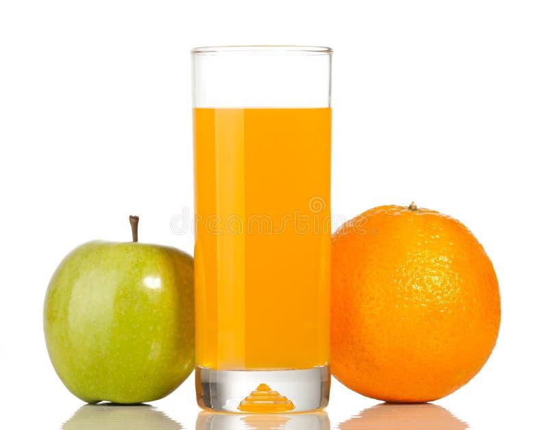 Orange und Glas Saft stockbilder