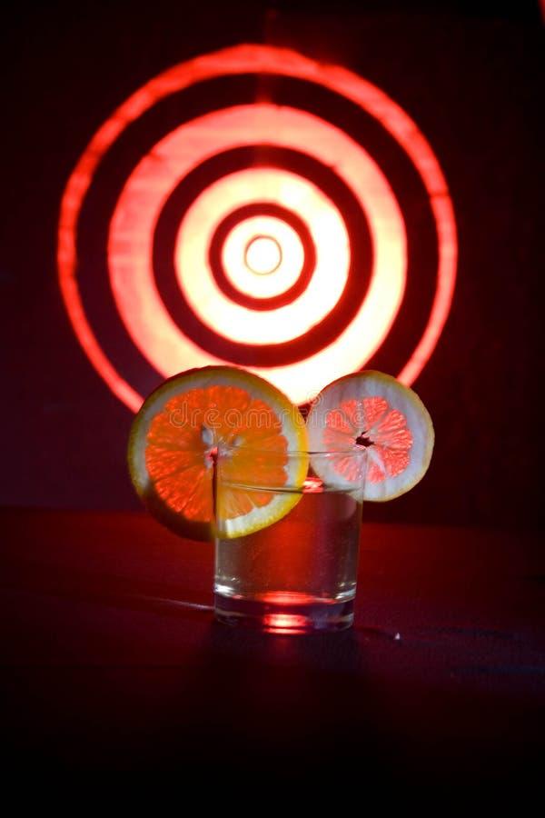 Orange und Zitrone auf Glas lizenzfreies stockfoto