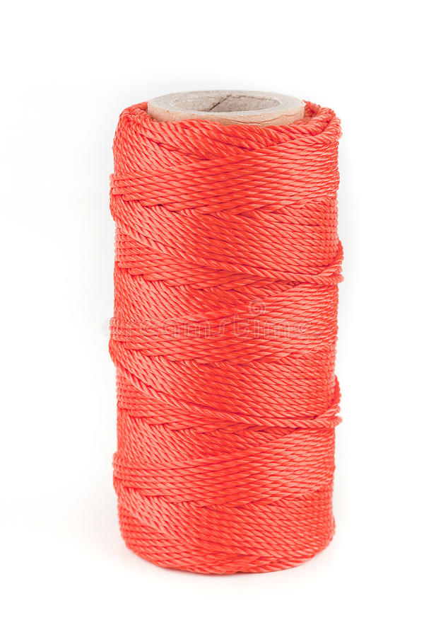 Orange utility rope. Spool of orange utility rope isolated on white stock photo