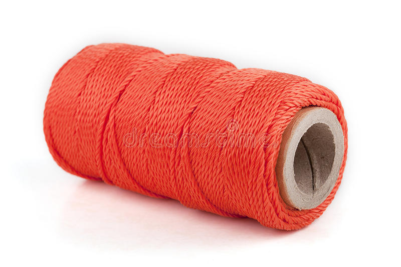 Orange utility rope. Spool of orange utility rope isolated on white royalty free stock photos