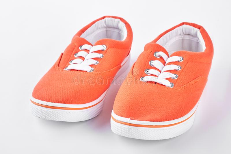 Orange vans on white background. stock photography