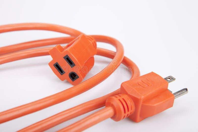 Orange Verlängerungskabel lizenzfreies stockbild