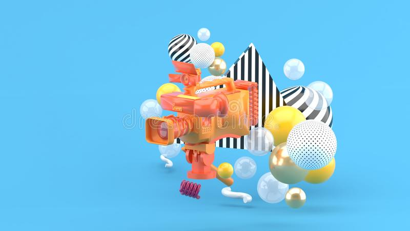 An orange video camera surrounded by colorful balls on a blue background stock illustration