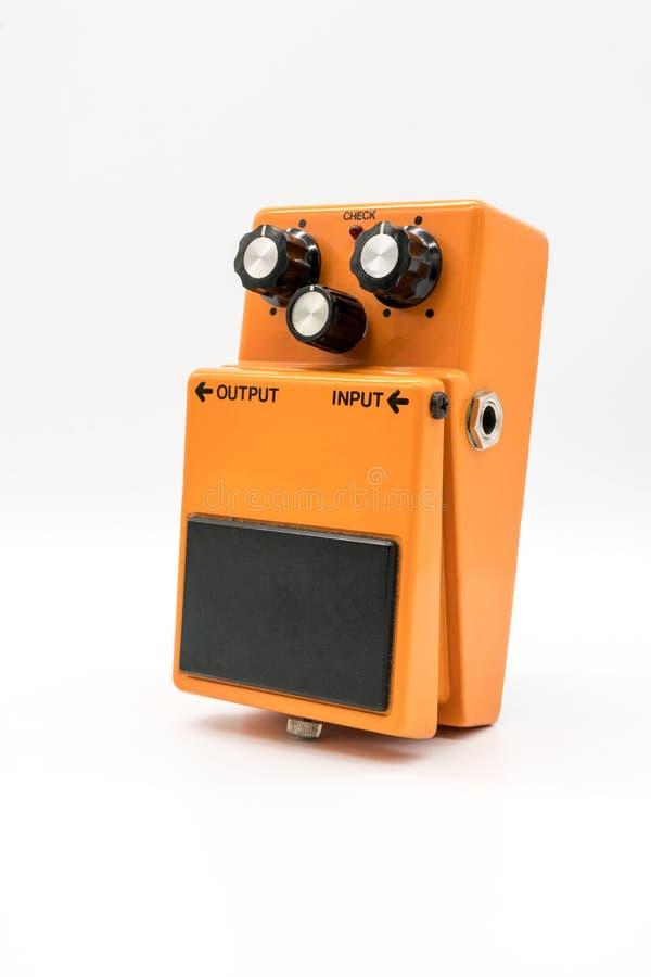 Orange vintage guitar pedal on white royalty free stock image