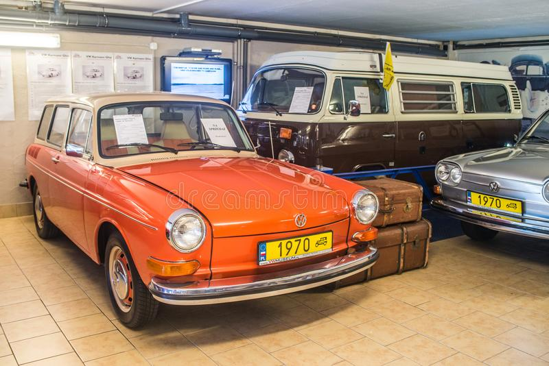 Orange Volkswagen 1600 of 1970 in museum. Beautiful white and orange VW Typ 2 1600 L Variant with 1600 ccm motor of 1970 in Volkswagen museum in Pepowo near stock images