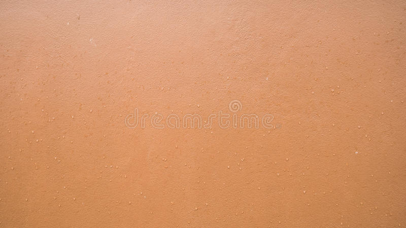Orange wall with rain drop texture background. Orange wall with rain drop texture background royalty free stock photography
