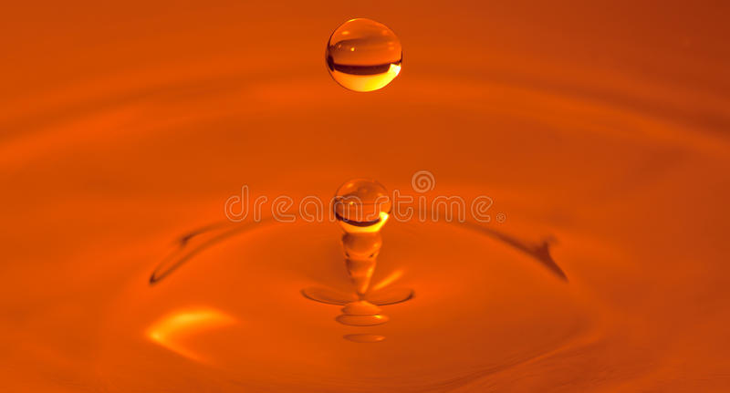 Orange Water Drop High Speed Photo royalty free stock photos