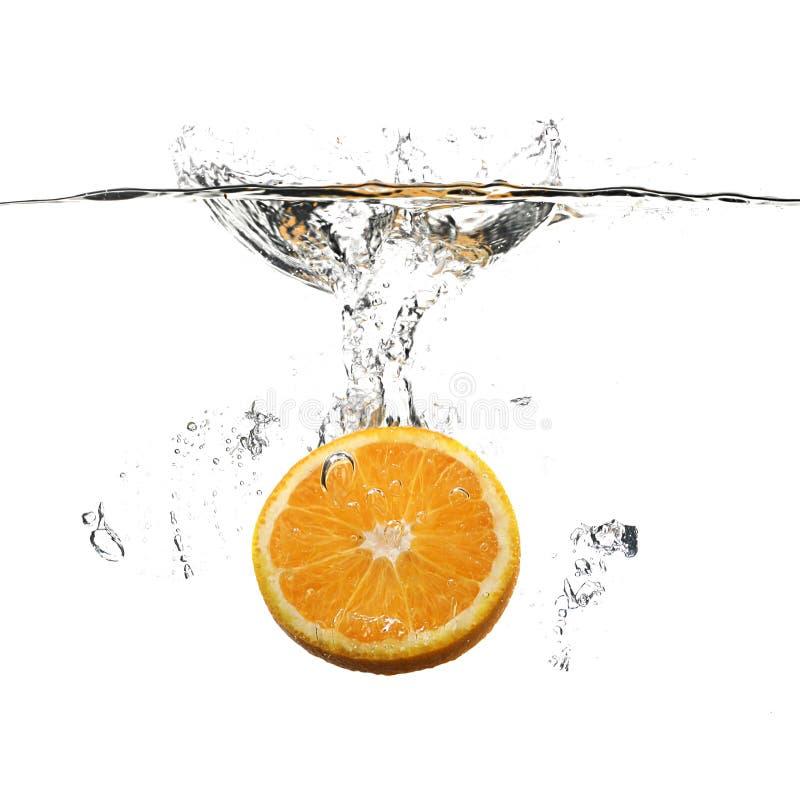 Orange with water splash. On white royalty free stock photo