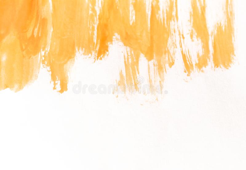 Orange watercolor brush strokes on white paper. Horizontal background with stains of watercolour paint. royalty free stock photo