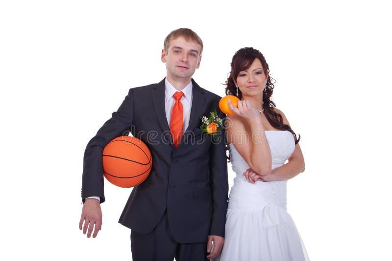 Orange wedding. Orange, basketball, tie, rose - everything is orange color in this wedding stock images