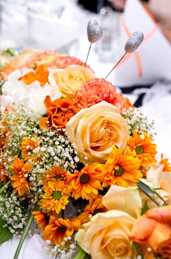 Orange wedding bouquet. Closeup of luxurious orange colored wedding flower bouquet stock photo