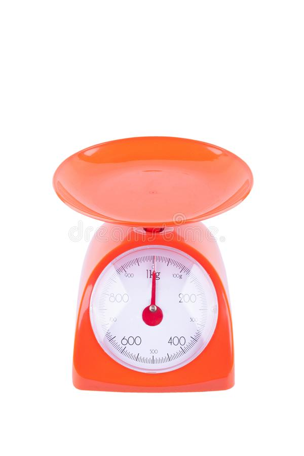Orange weighing scales with pan and dial on white background kitchen equipment object isolated royalty free stock image