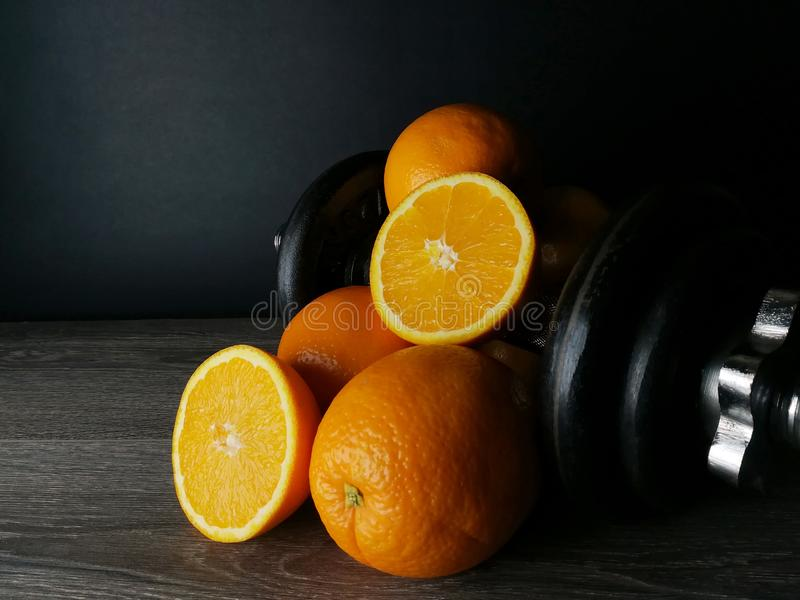 Orange with weights, health and fitness stock photo