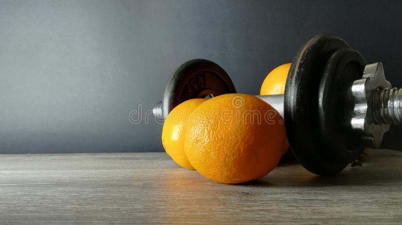 Orange with weights, health and fitness royalty free stock photos