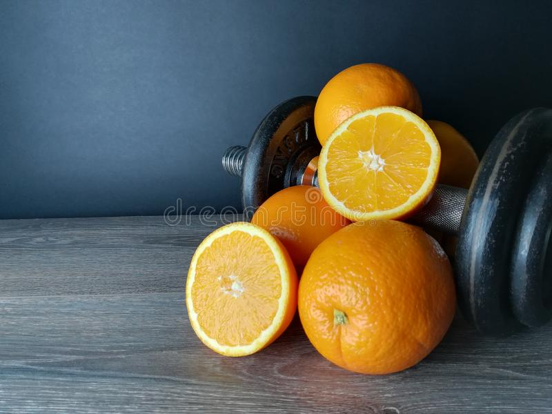 Orange with weights, health and fitness royalty free stock image