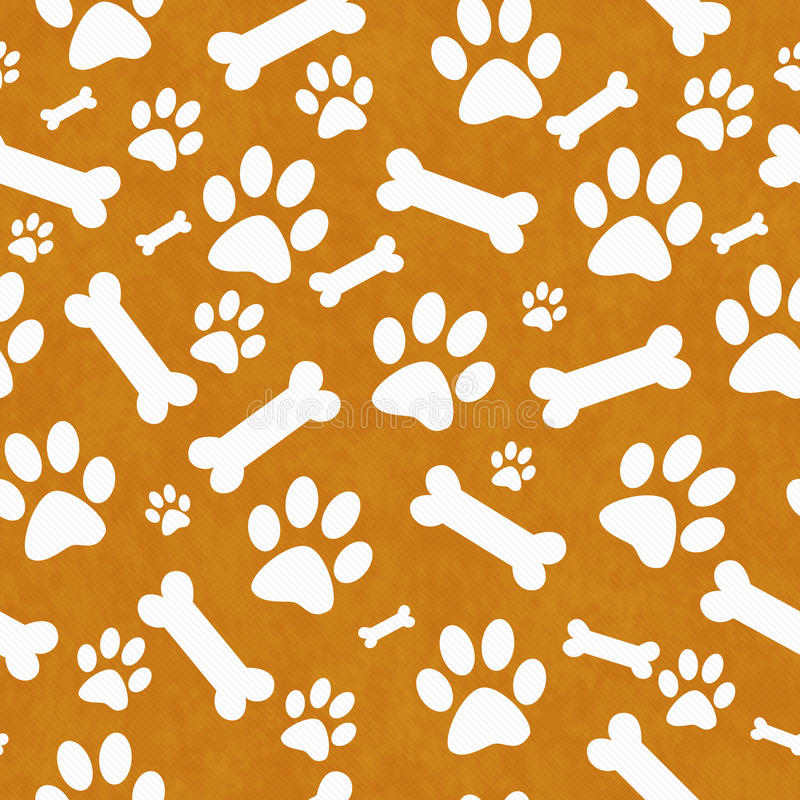 Orange and White Dog Paw Prints and Bones Tile Pattern Repeat Ba. Ckground that is seamless and repeats royalty free stock photos