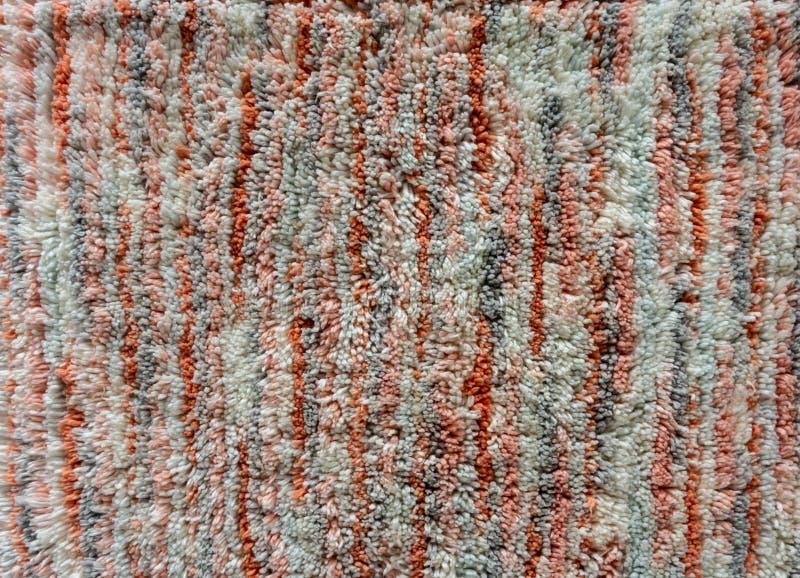 Orange, white and grey carpet texture. For background stock photos
