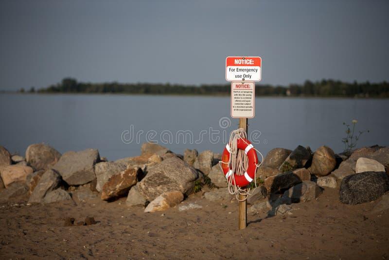 Life Preserver Saver Beach Swim Rocky Shore stock photos
