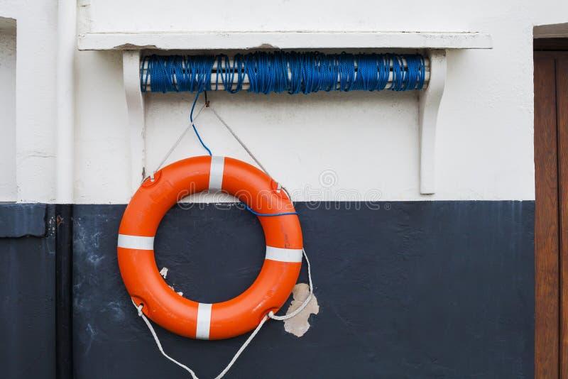 Orange and white Lifebelt at Scarborough. Orange and white lifesaving lifebelt on sea front at Scarborough, Yorkshire, United Kingdom stock photos