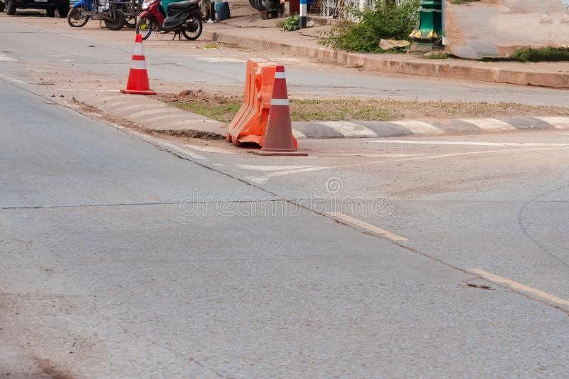 Orange and white traffic cones stand on street stock photo