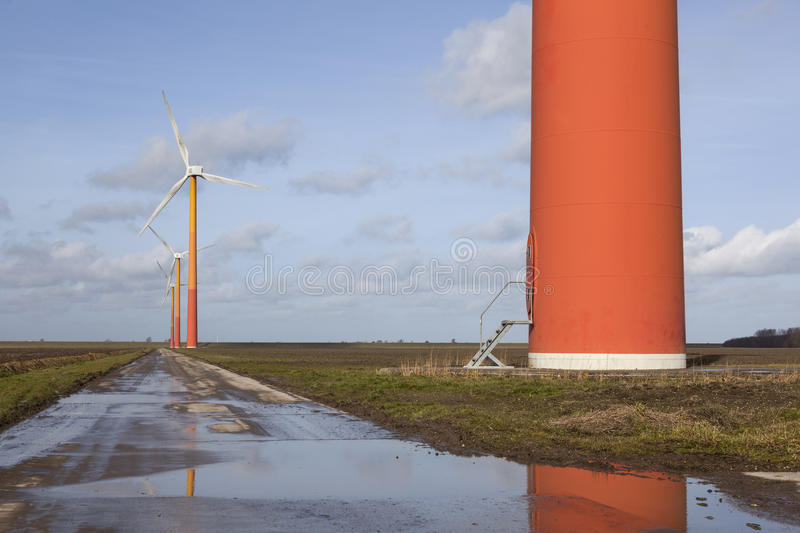 Orange wind turbines on the dutch island of flevoland near Almere. Orange wind turbines in the netherlands on the island of flevoland near Almere with blue sky royalty free stock photography