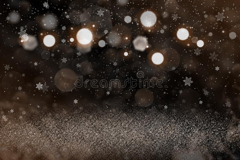 Orange wonderful bright abstract background glitter lights with falling snow flakes fly defocused bokeh - festive mockup texture. With blank space for your royalty free stock images