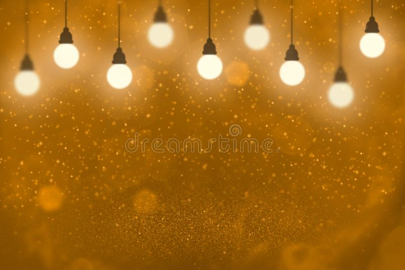 Orange wonderful shining glitter lights defocused light bulbs bokeh abstract background with sparks fly, festal mockup texture. Orange nice shining abstract royalty free stock photography
