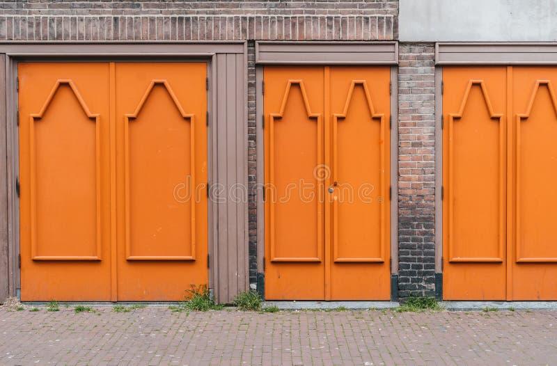 Orange wooden stylish doors royalty free stock photo