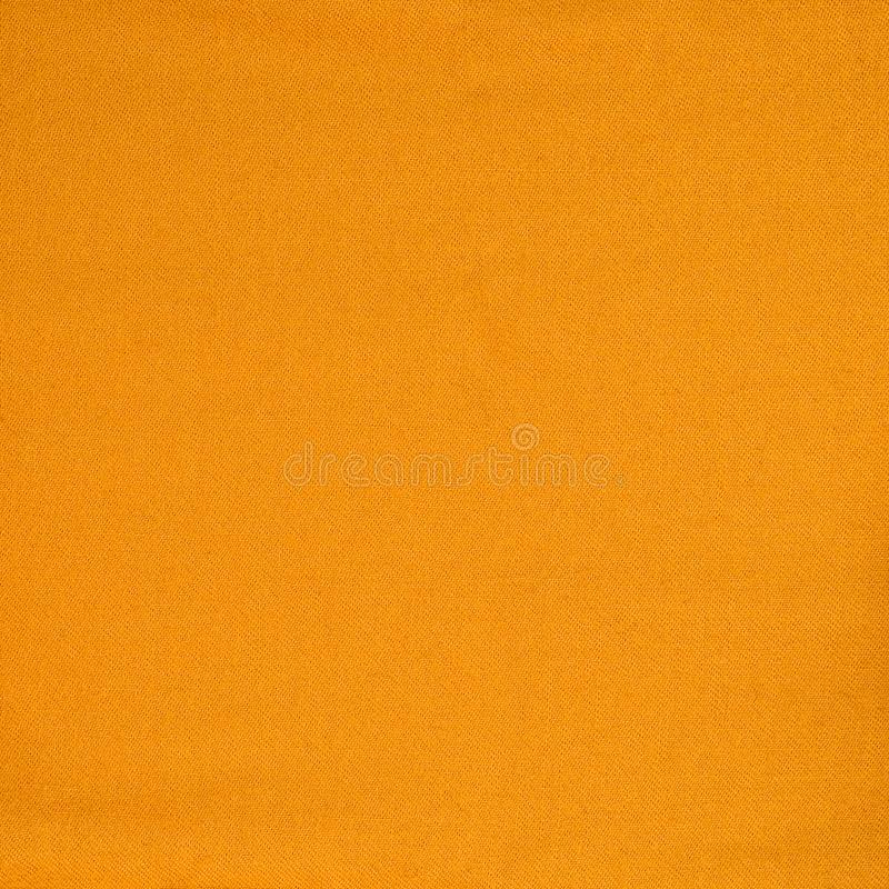 Orange woolen texture fabric. Cashmere. Solid seamless background stock image