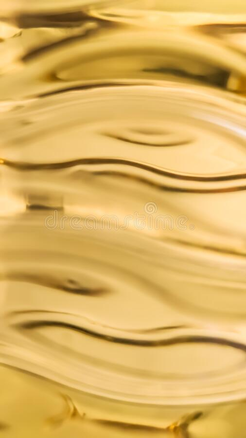 Orange and yellow background of abstract warm curves, hot wave, continuous lines with neon glow. template for card or stock photography