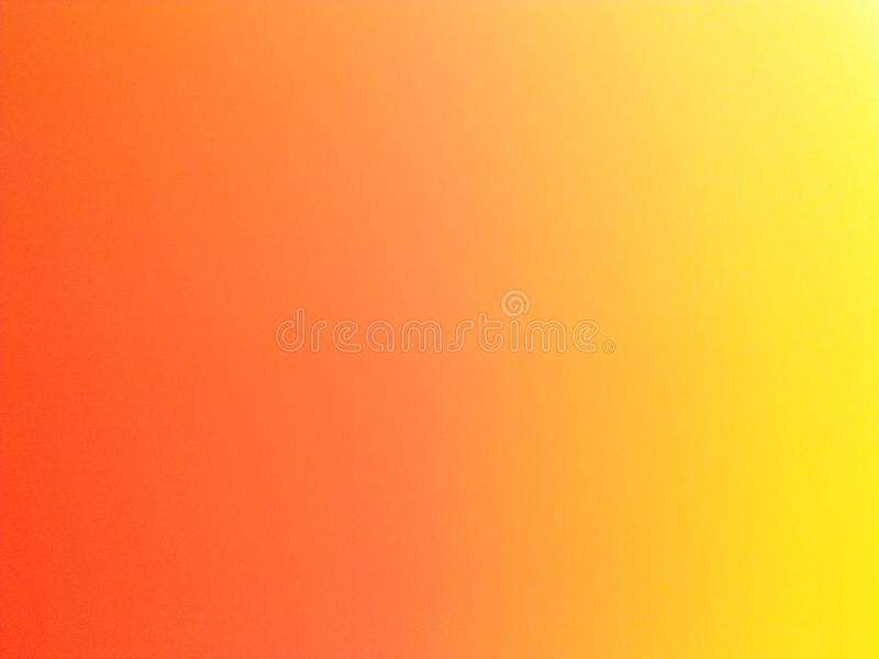 Orange/Yellow background - This photo was taken because my camera dropped stock photography
