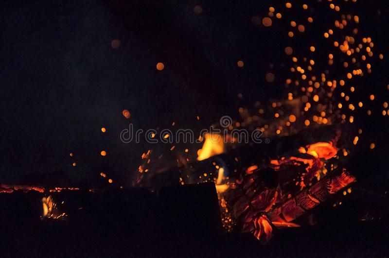 Flame of fire with sparks in the night royalty free stock image