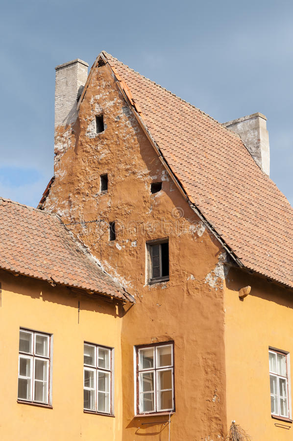 Orange and yellow house. Old orange and yellow house in the Old Town of Tallinn, Estonia royalty free stock photography