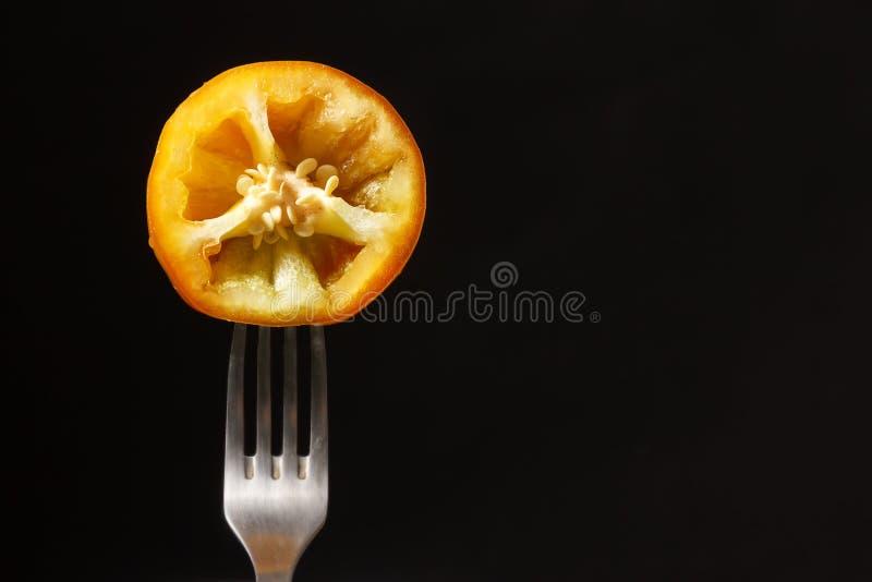 Orange pepper isolated on the black background stock images