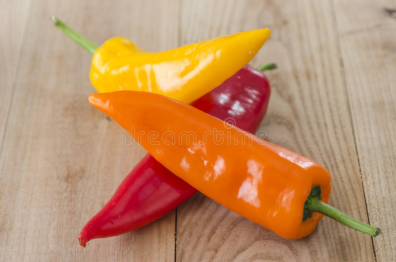 orange, yellow and red bell pepper. royalty free stock photos