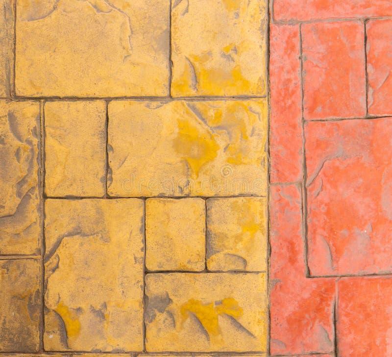 Orange Yellow rock floor tiles for texture background. Brown rock marble floor tiles for texture background stock images