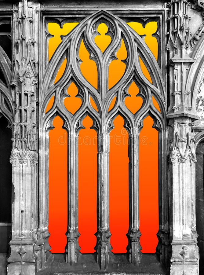 Light Behind a Gothic Window. An orange and yellow sunburst gradient back lights a stone gothic church window royalty free stock images