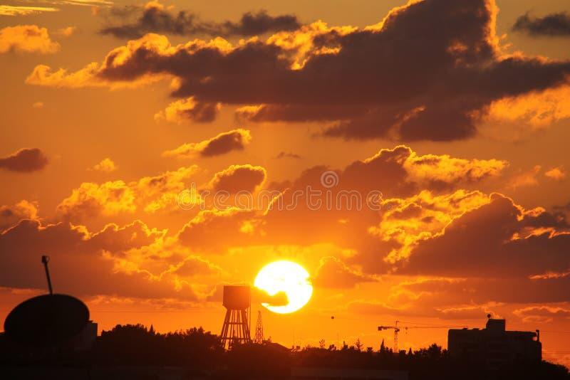 Orange and Yellowish Sunset Over Water Tower royalty free stock photo