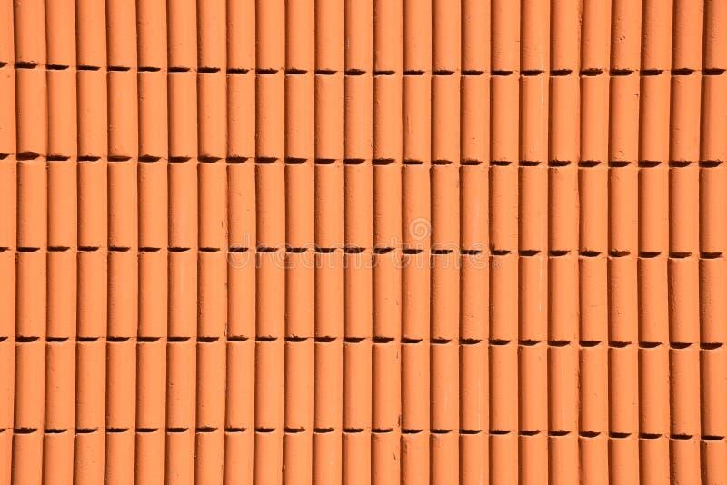 Orange Zementwand im Tageslicht stockfotografie