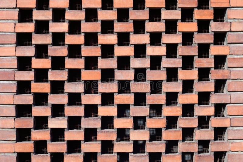 Orange Ziegelsteinwandbeschaffenheit mit Belüftung stockbilder