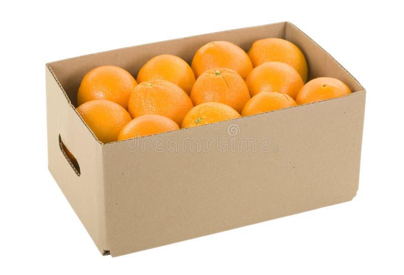 Orangen im Kasten lizenzfreie stockfotos