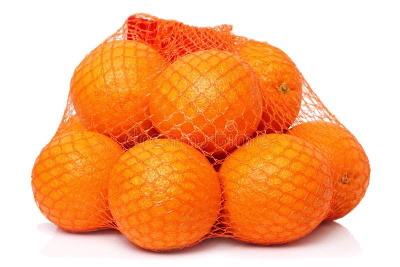 Orangen im Rasterfeld stockbilder